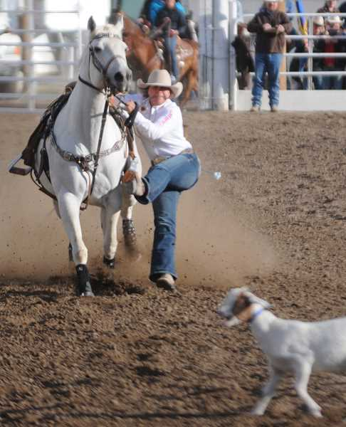 by: LON AUSTIN/CENTRAL OREGONIAN - Riley Sappington makes a goat tying run during the Oregon High School Rodeo Association State Finals, which were held in Prineville in June. Sappington qualified for the national finals where she recently placed 17th in the event. Nationals were held in Rock Springs, Wyo., July 13-19.