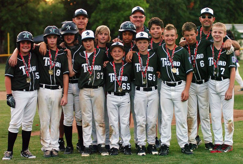 by: DAN BROOD - GREAT TOURNAMENT -- The Tigard Little League ages 10-11 baseball team gathers after playing in the championship game of the Oregon State Tournament. Tigard was edged 11-10 by Hermiston in the title tilt.