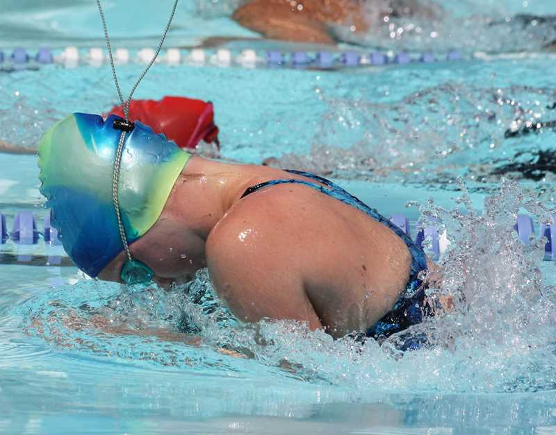 by: PHOTO COURTESY OF ALLIE THURMAN - Cora White races towards the finish line of the 50-meter breast stroke during the High Desert Invitational Swim Meet. White won the girls 15-18 age group in the event with a time of 1:38.60.