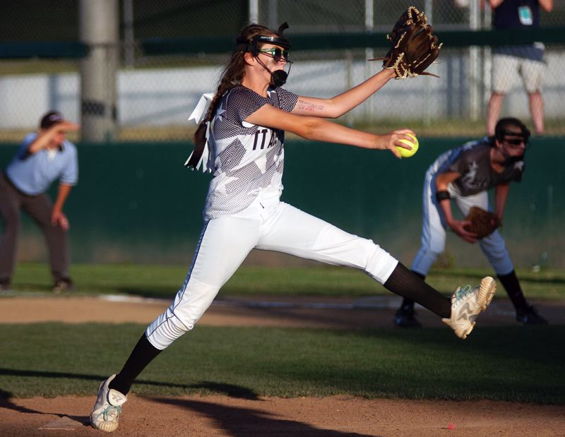 by: DAN BROOD - Elizabeth Hillier gets ready to fire a pitch to the plate during the District 4 championship game.