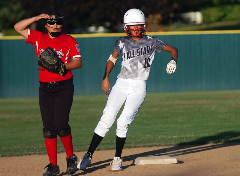 by: DAN BROOD - Tigard/TC's Tia Cordts gets to second base aftter hitting a leadoff double in the second inning of the district title contest.