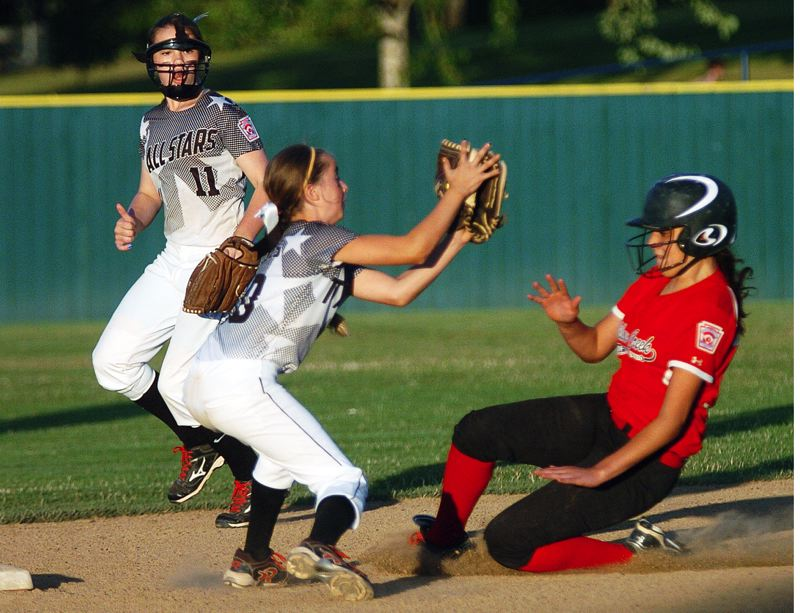 by: DAN BROOD - Shortstop Bella Valdes, with second baseman Logan Mentzer behind her, is about to tag out Willow Creek's Nevaeh Bergner on a stolen base attempt.