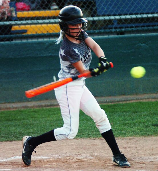 by: DAN BROOD - Alexis Klum takes a big swing during the District 4 championship game.