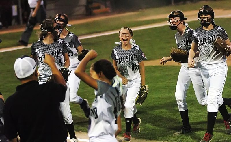 by: DAN BROOD - There are many happy faces after the Tigard/Tualatin City team ended a Willow Creek scoring threat.