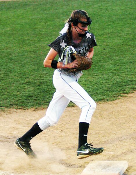 by: DAN BROOD - First baseman Jennifer Redfern runs to the bag after fielding a grounder in the district title game.