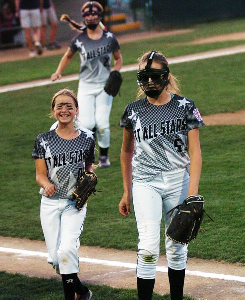 by: DAN BROOD - Shortstop Bella Valdes (left) shares a smile with pitcher Elizabeth Hillier.