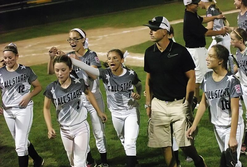 by: DAN BROOD - More celebration for the Tigard/Tualatin City team, which earned a berth to the Little League Softball World Series.