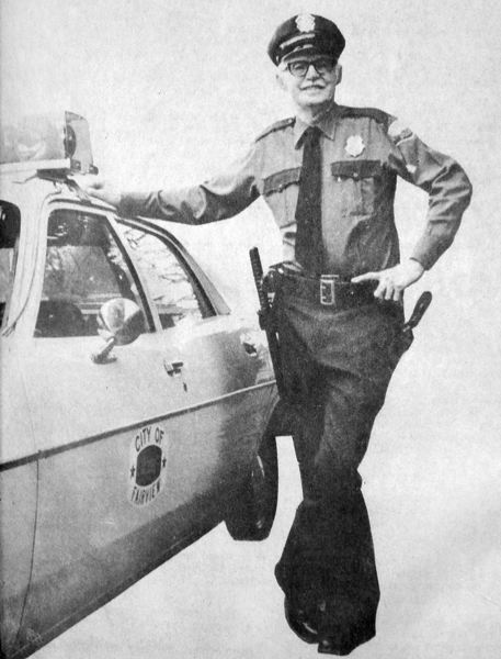 by: OUTLOOK FILE PHOTO - Fairview Chief of Police Oren Wes Olin posed with his marked police vehicle, the first for the city of Fairview, in 1979.