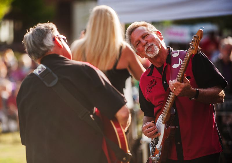 by: SPOKESMAN PHOTO: JOSH KULLA - Johnny Limbo and the Lugnuts' bassist Matt Kenney rocks out July 24 at Wilsonville's Town Center Park as the Wilsonville Rotary Summer Concert Series opened.