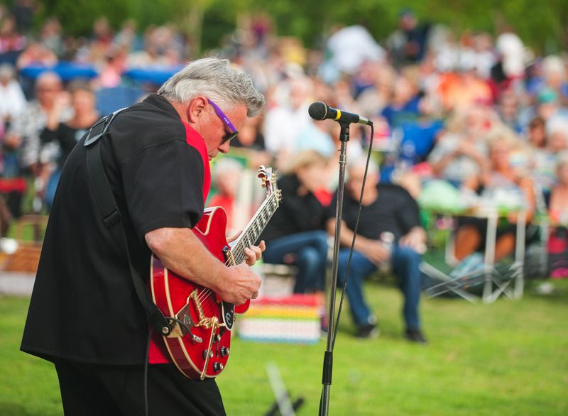 by: SPOKESMAN PHOTO: JOSH KULLA - Lugnuts' guitarist Rouke vanDerVeen tears into a solo at Town Center Park.