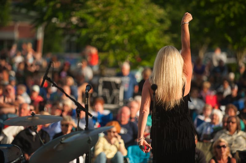 by: SPOKESMAN PHOTO: JOSH KULLA - Lugnuts' vocalist Barbara Cecil wraps up a song with a flourish July 24 at Wilsonville's Town Center Park.