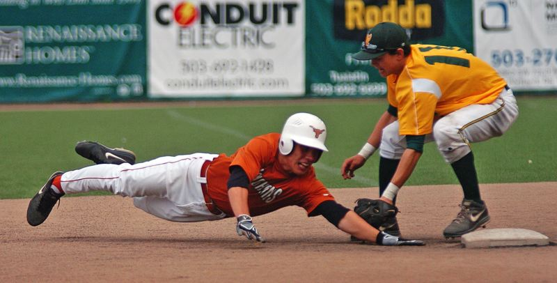 by: DAN BROOD - West Linn shortstop Tim Tawa makes a tag in the Lions' OIBA playoff win over Tigard.