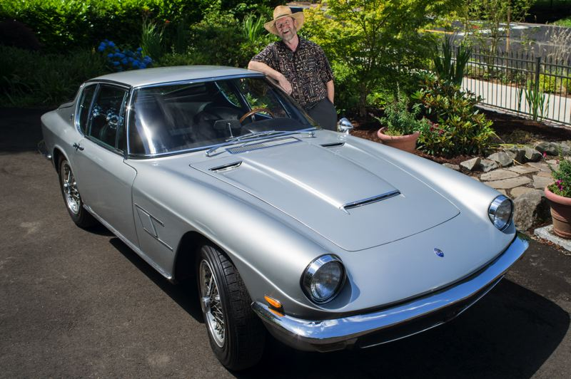 by: TRIBUNE PHOTO CHASE ALLGOOD - Rick Martin with his rare and beautiful 1967 Maserati Mistral, just one of many classic cars at this year's Columbia River Concours d'Elegance.