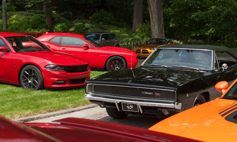 by: TRIBUNE PHOTO JOHN M. VINCENT - The old and the new: A 1968 Dodge Charger HEMI passes a 2015 Dodge Charger during a recent event to commemorate the company's 100th anniversary.