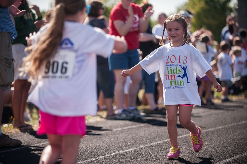 by: SPOKESMAN PHOTO: JOSH KULLA - The finish line was a crowded place Saturday at the Kiwanis Kids Fun Run.