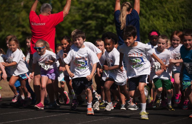 by: SPOKESMAN PHOTO: JOSH KULLA - A heat leaves the starting line July 26 at the WIlsonville Kiwanis Kids Fun.