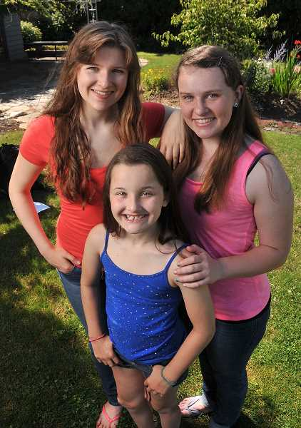 by: PAMPLIN MEDIA GROUP: VERN UYETAKE - Clockwise from left: Annika and Kaitamaria Pounds and their sister Karra Kaiser are planning to compete in the National American Miss pageant this fall.