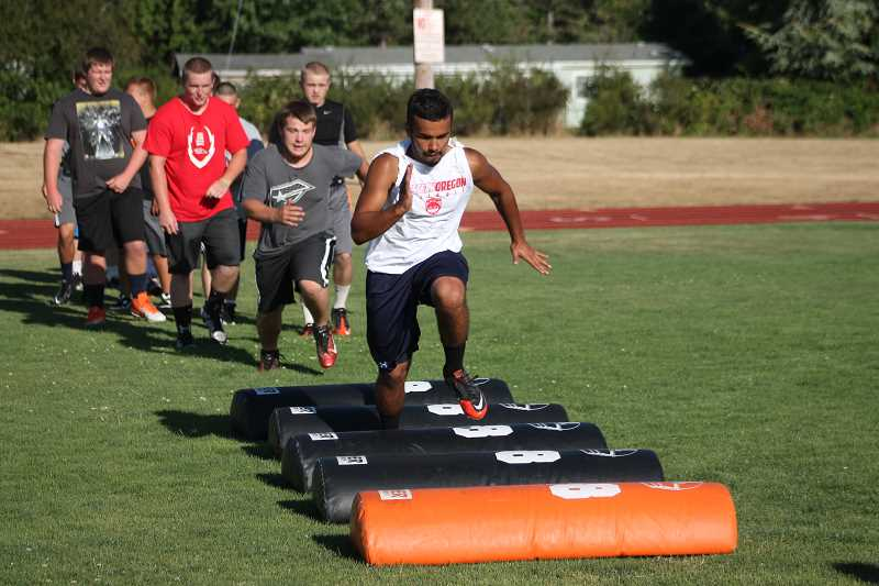 by: JIM BESEDA/MOLALLA PIONEER - Isaiah Ganz was among the Molalla High football players who took part in recent summer workouts at Burghardt Stadium.