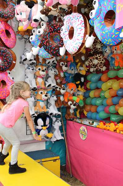 Photo Credit: NEWS-TIMES PHOTO: STEPHANIE HAUGEN - Youngsters filled the county fairgrounds last week, trying to win big plush novelties.