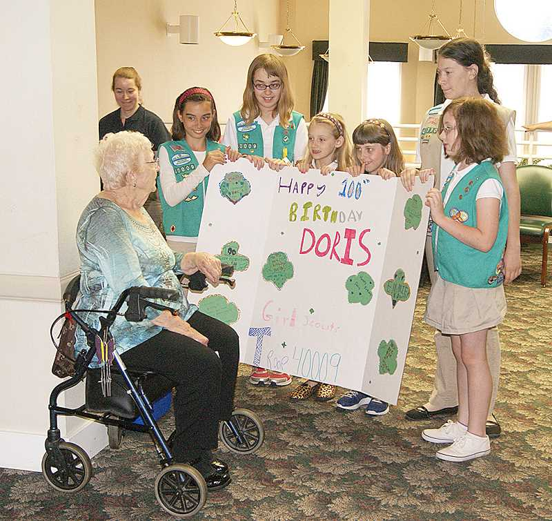 Doris Johnson is honored by Canby Girls Scout Troop 40009 at Hope Village to help celebrate her 100th birthday.