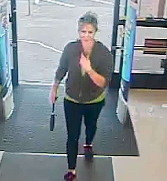 Photo Credit: COURTESY OF THE NDPD - A surveillance camera caught Jennifer Huston entering the Newberg Rite-Aid store Thursday evening. Police say store records indicate she purchased Gatorade, trail mix and over-the-counter sleep aids.