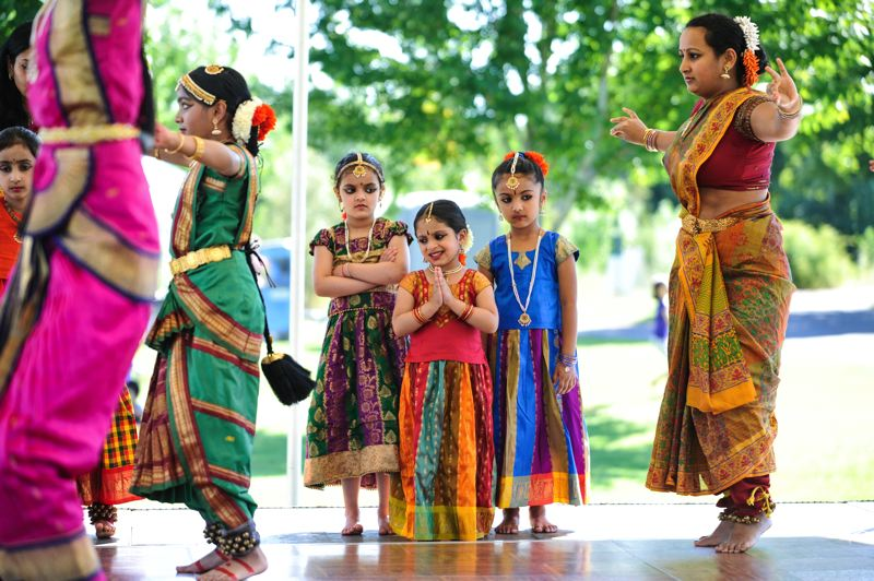 by: TIMES PHOTOS: JOHN LARIVIERE - Young dancers of the Jayanthi Raman NATYA Dance Academy watch senior dancers during a performance at the Beaverton International Celebration.