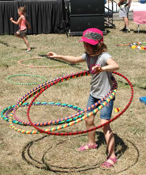 by: ISABEL GAUTSCHI - Thanks to Circus Cascadia, children tried out their circus skills.