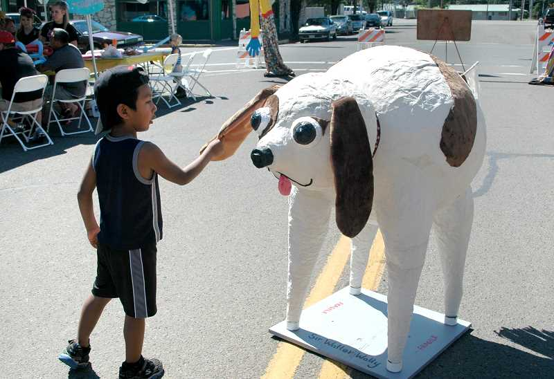 by: ISABEL GAUTSCHI - A young man checks out the new puppet made by artist Nina Bradford for the 2014 Estacada Summer Celebration.