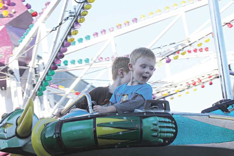 by: JEFF WILSON - A small boy shows his delight on the Davis Amusement Cascadia Octopus ride on Saturday at the Jefferson County Fair. The boy and his older brother were among hundreds of happy kids enjoying the wide variety of family-friendly rides.