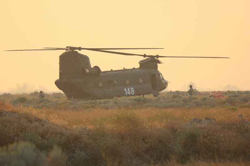 by: JEFF WILSON - During the worst of the smoky conditions from area wildfires, a National Guard Chinook helicopter lands at the Madras Municipal Airport.