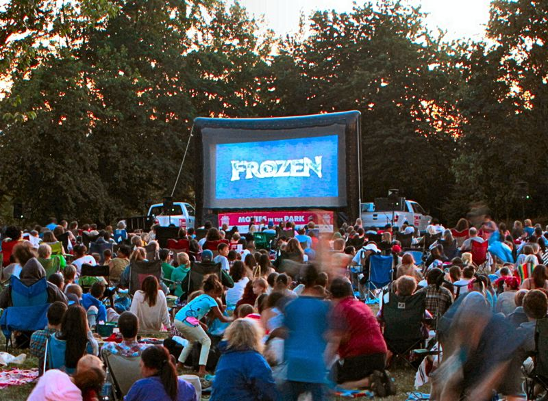 by: DAVID F. ASHTON - As the sun goes sets, the animated feature Frozen rolls in front of some 1,200 in small Hazeltine Park.