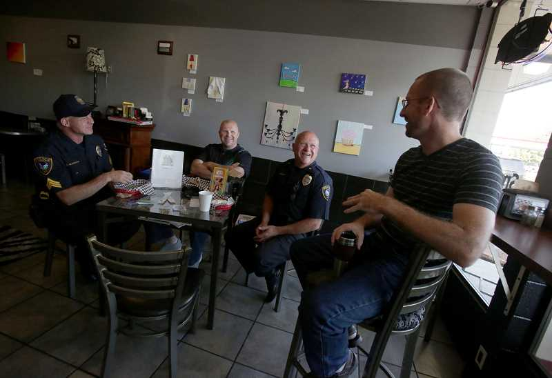 Photo Credit: TIMES PHOTO: JONATHAN HOUSE - Tigard Police Sgt. Jamie McDonald, Officer T.J. Hahn and Lt. Erick Boothsby chat with West Coast Bagels owner Eric Jeroch during the departments monthly Coffee with a Cop event. The public is encouraged to come and chat with officers in a non-intimidating environment.