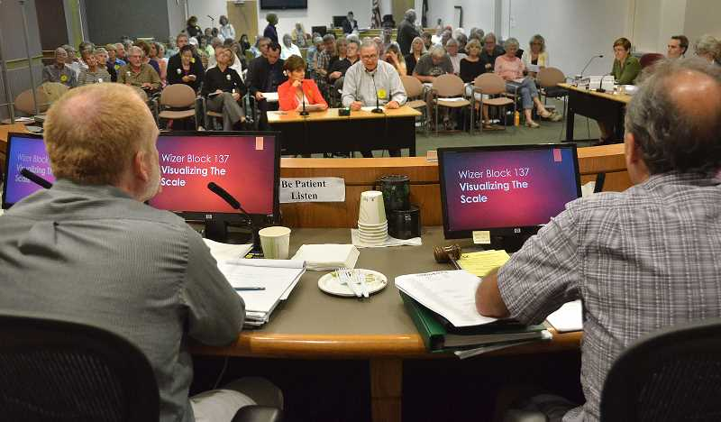 Photo Credit: REVIEW PHOTO: VERN UYETAKE - Development Review Commission members listen to public testimony during the second of two hearings last week on the proposed development of the Wizer Block in downtown Lake Oswego.
