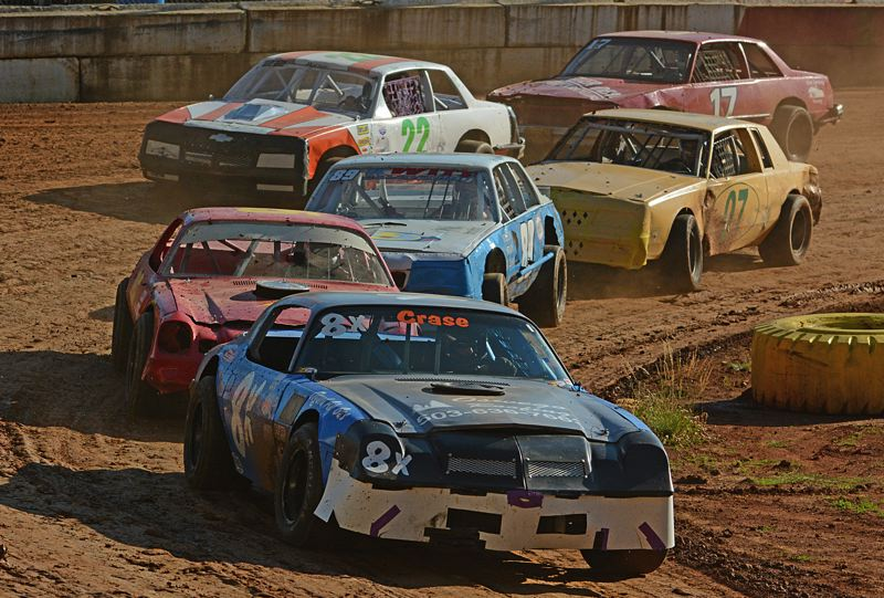 Photo Credit: JOHN WILLIAM HOWARD - Mike Crase rounds the first turn in the lead of the Street Stock Division on Saturday.