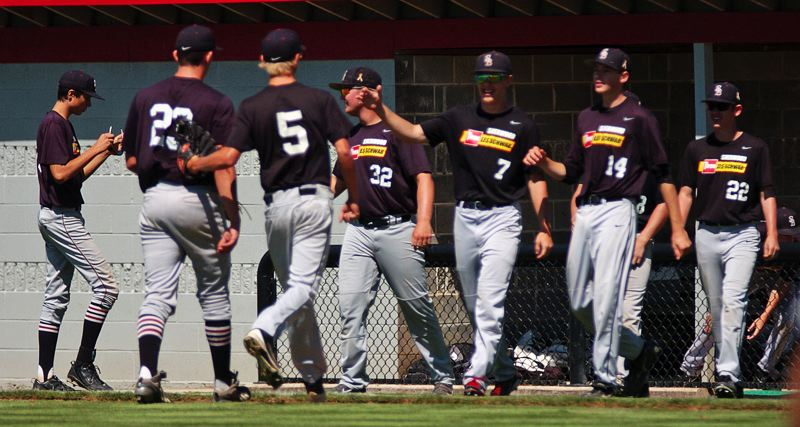 Photo Credit: DAN BROOD - WE WIN -- The Bowmen celebrate following their 2-1 win over Clackamas Saturday at the OIBA tournament held at Oregon City.
