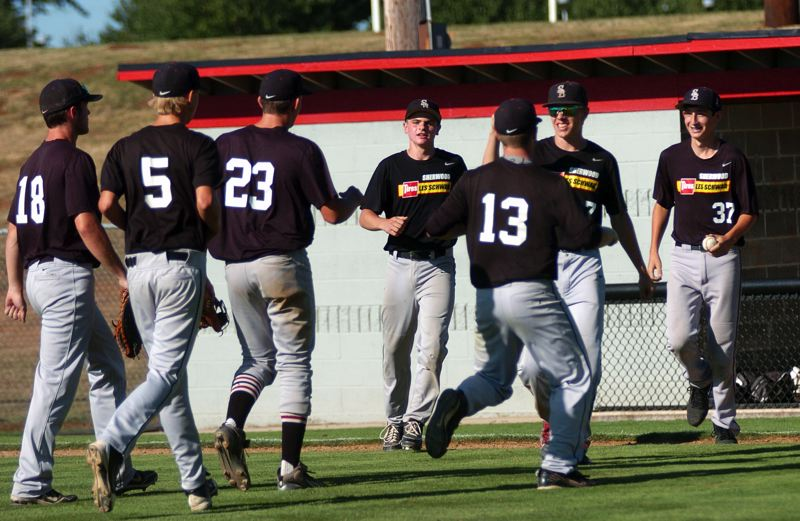 Photo Credit: DAN BROOD - WE DID IT -- Members of the Sherwood OIBA baseball team start celebrating following their 5-4 win over Lake Oswego in Saturday's OIBA tournament title game at Oregon City.