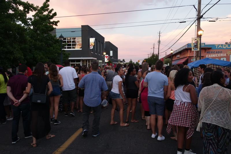 Photo Credit: JOSEPH GALLIVAN - Revellers in Northeast Portland enjoyed an incident-free art walk on  Northeast Alberta St on a warm Thursday evening on July 31, 2014