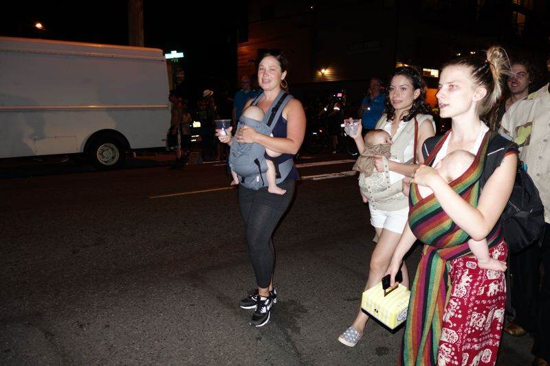 Photo Credit: JOSEPH GALLIVAN - Mommy's night out: Unidentified revelers in Northeast Portland enjoyed an incident-free art walk on  Northeast Alberta St on a warm Thursday evening on July 31, 2014
