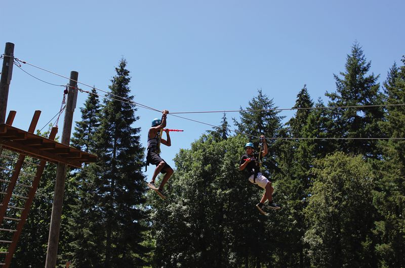 Photo Credit: HILLSBORO TRIBUNE PHOTO: KATE STRINGER - Lovell Soares, 16, from Hawaii, shoots a nerf dart at his cousin Camen, also 16, from Portland. The cousins did the zipline course multiple times at the Tree to Tree Adventure Camp.