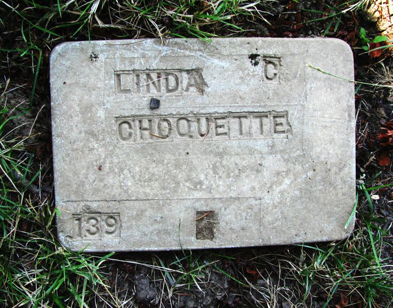 Photo Credit: OUTLOOK PHOTO: BEVERLY CORBELL - Some headstones at the Gresham Pioneer Cemetery are mysteries. That of Linda C. Choquette has no birth or death date, only the number 139 in the corner.