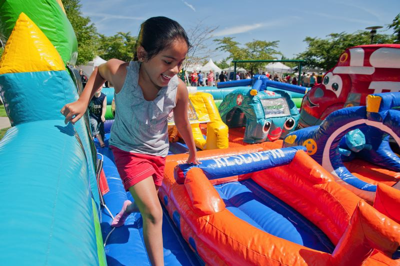 Photo Credit: SPOKESMAN FILE PHOTO - There are always plenty of inflatable attractions for kids at Fun In The Park, set for this Saturday in Town Center Park.