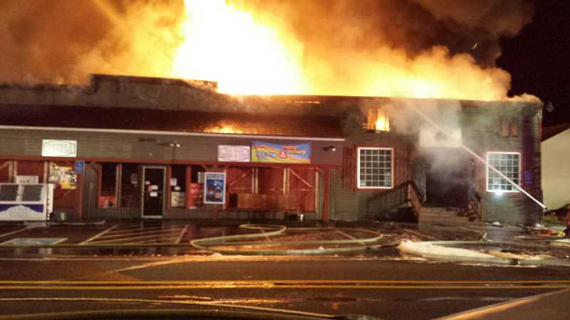 Photo Credit: COURTESY OF ESTACADA FIRE DISTRICT - Investigators say the June 14 fire that destroyed the 100-year-old building that housed Bailey's Pub & Grub and the Currinsville Store was deliberately set.