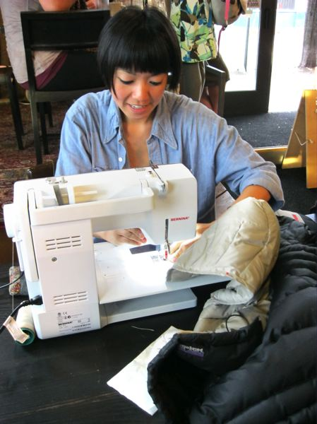Photo Credit: CONTRIBUTED: CITY OF GRESHAM - Volunteers at Repair Cafe, this one held in Portland, give their time to help with sewing and other repairs.