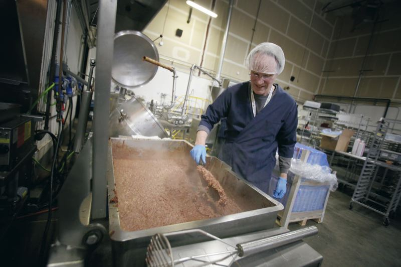 Photo Credit: PAMPLIN MEDIA GROUP: JONATHAN HOUSE  - Better Bean Co. president Keith Kullberg checks on the consistency of a batch of cooked beans at the company's Wilsonville plant.