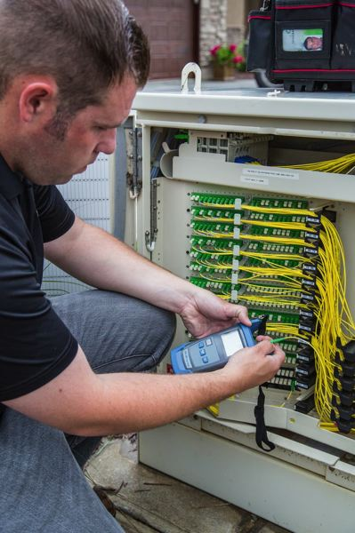 Photo Credit: COURTESY CENTURYLINK - A CenturyLink technician works on the company's 1 gigabit broadband service.