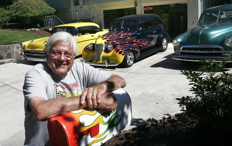 Photo Credit: JIM CLARK - Vern Farris stands in front of three of the classic cars he owns. The Gladstone man is getting ready to direct Greshams annual Rockin Round the Block classic car cruise-in, Friday and Saturday, Aug. 8-9.