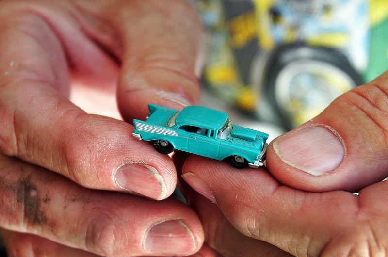 Photo Credit: JIM CLARK - Farris holds one of the smallest of the hundreds of model cars he owns. His wife enjoys cars as well, and also collects Elvis Presley and Lucille Ball memorabilia.