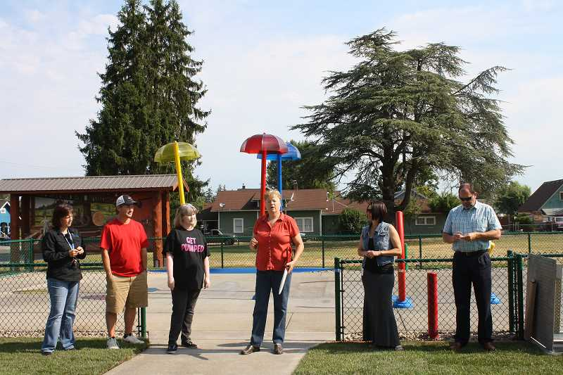 Photo Credit: PEGGY SAVAGE - Mayor Debbie Rogge prepares to cut the ribbon to the splash pad