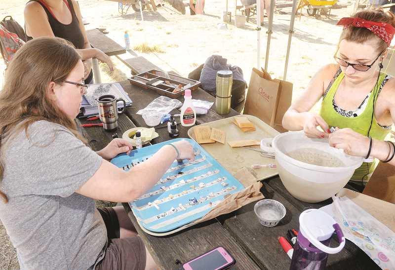 Photo Credit: GARY ALLEN - Moira Manion (right) and Maryanne Maddoux clean artifacts found at the dig.