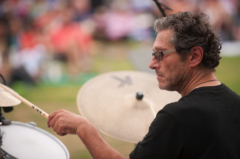 Photo Credit: SPOKESMAN PHOTO: JOSH KULLA - Drummer Michael Braun, who once toured and played with Hall and Oates, performs with Aaron Meyer's band at Town Center Park in Wilsonville.
